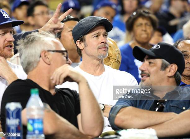 Actors Brad Pitt and Danny Nucci attend The Los Angeles Dodgers Game at Dodger Stadium on April 10 2018 in Los Angeles California