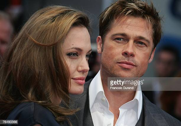 """Actors Brad Pitt and his wife Angelina Jolie arrive for the premiere of """"The Assassination of Jesse James by the Coward Robert Ford"""" during the 33rd..."""