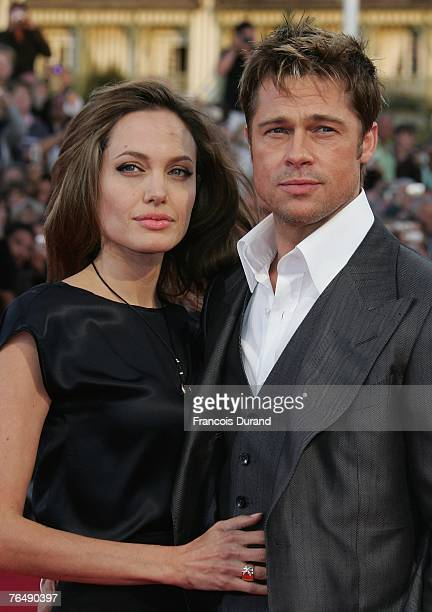 "Actors Brad Pitt and his wife Angelina Jolie arrive for the premiere of ""The Assassination of Jesse James by the Coward Robert Ford"" during the 33rd..."