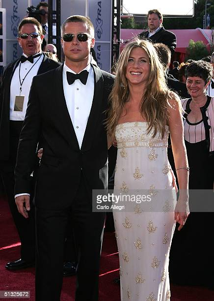 Actors Brad Pitt and Jennifer Aniston attend the 56th Annual Primetime Emmy Awards at the Shrine Auditorium September 19 2004 in Los Angeles...