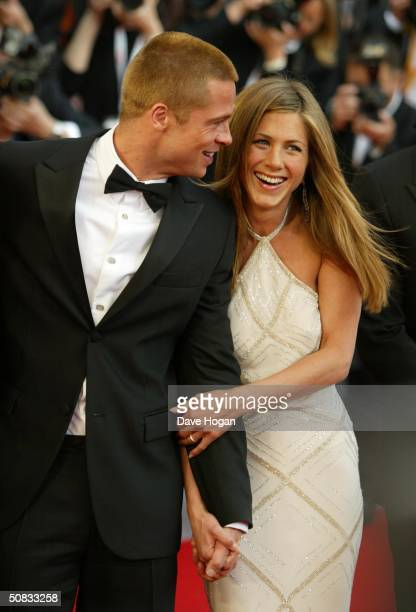 Actors Brad Pitt and Jennifer Aniston attend the World Premiere of epic movie 'Troy' at Le Palais de Festival on May 13 2004 in Cannes France Aniston...