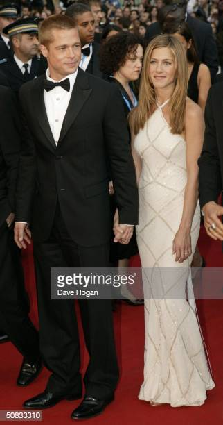 Actors Brad Pitt and Jennifer Aniston attend the World Premiere of epic movie Troy at Le Palais de Festival on May 13 2004 in Cannes France Aniston...