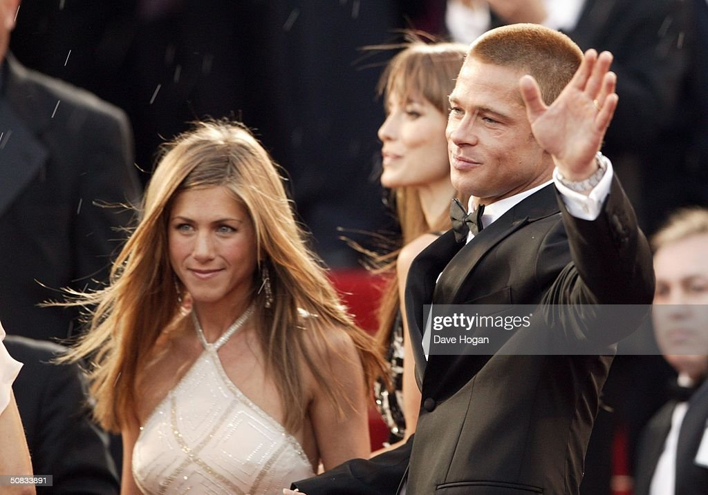 Actors Brad Pitt and Jennifer Aniston attend the World Premiere of epic movie 'Troy' at Le Palais de Festival on May 13, 2004 in Cannes, France. Aniston wears a dress by Versace.