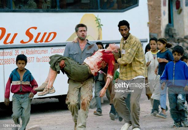 Actors Brad Pitt and Mohamed Akhzam carrying actress Cate Blanchett whilst filming 'Babel' on location in Morocco 2005 The film was directed by...