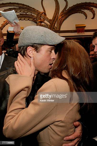Actors Brad Pitt and wife Angelina Jolie embrace during the arrivals for the premiere of Paramount Pictures' 'Beowulf' at the Westwood Village...