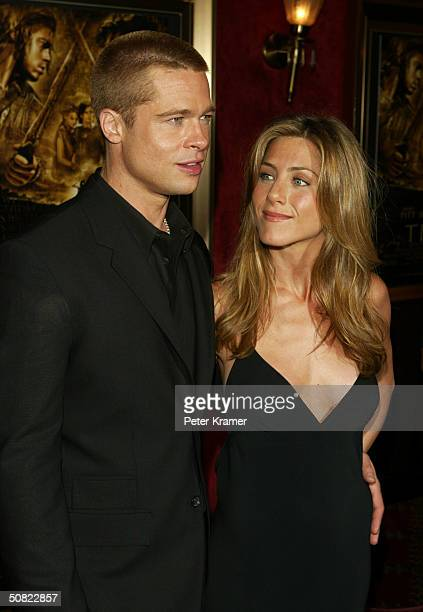 """Actors Brad Pitt and wife Jennifer Aniston attend the premiere of """"Troy"""" on May 10, 2004 in New York City."""