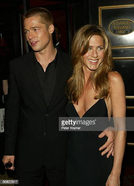 "Actors Brad Pitt and wife Jennifer Aniston attend the premiere of ""Troy"" on May 10, 2004 in New York City."