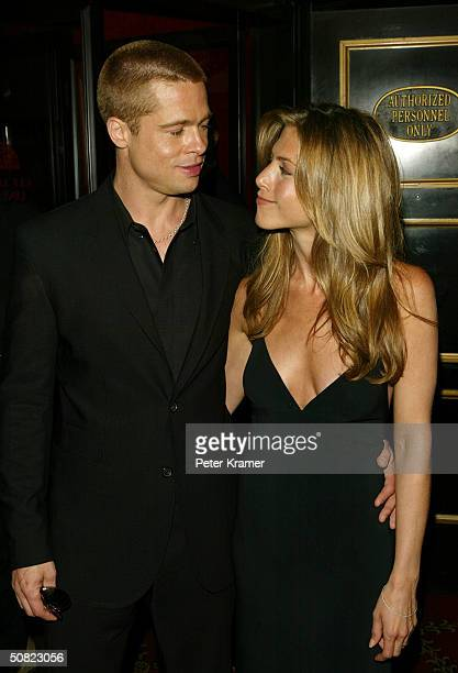 Actors Brad Pitt and wife Jennifer Aniston attend the premiere of Troy on May 10 2004 in New York City