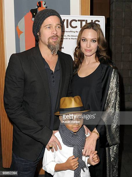 Actors Brad Pitt Angelina Jolie and their son Maddox arrive at the premiere of Warner Bros Pictures' and Spyglass Entertainment's Invictus at the...
