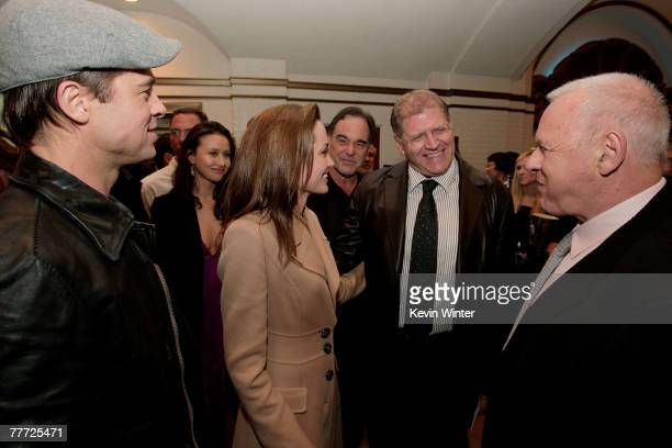 Actors Brad Pitt Angelina Jolie director Robert Zemeckis and actor Anthony Hopkins talk during arrivals at the premiere of Paramount Pictures'...