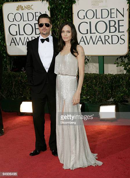 Actors Brad Pitt left and Angelina Jolie arrive for the 66th Annual Golden Globe Awards in Beverly Hills California US on Sunday Jan 11 2009 Heath...