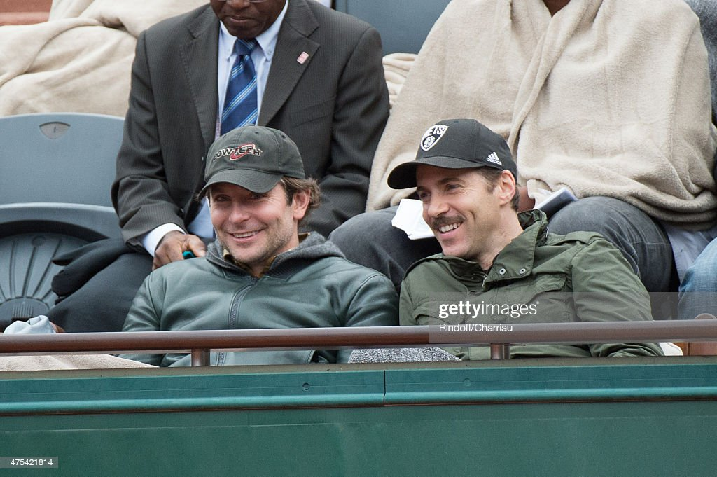 Actors Bradley Cooper and Alessandro Nivola attend the French open at Roland Garros on May 31, 2015 in Paris, France.