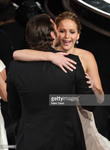 Actors Bradley Cooper and Jennifer Lawrence embrace in the audience during the Oscars held at the Dolby Theatre on February 24, 2013 in Hollywood,...