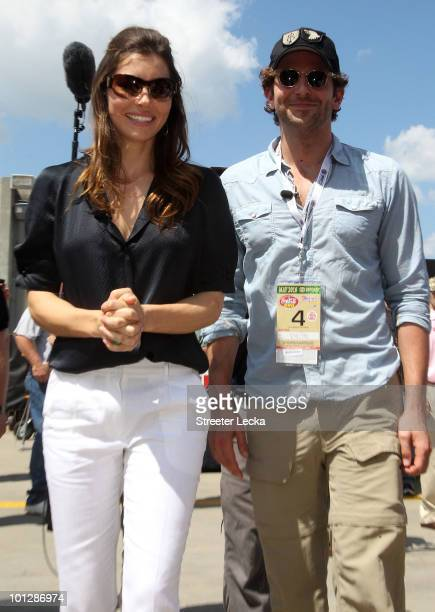 Actors Bradley Cooper and Jessica Biel tour the garages prior to the NASCAR Sprint Cup Series CocaCola 600 at Charlotte Motor Speedway on May 30 2010...