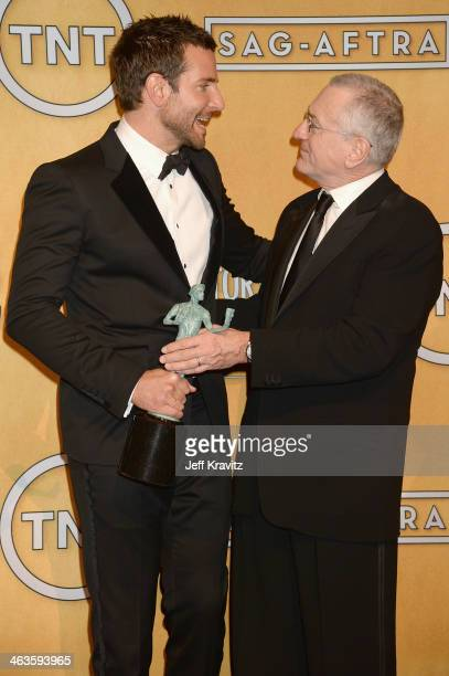 Actors Bradley Cooper and Robert De Niro pose in the press room during the 20th Annual Screen Actors Guild Awards at The Shrine Auditorium on January...