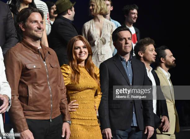 "Actors Bradley Cooper Isla Fisher Will Arnett Jeremy Renner and Jake Johnson onstage during CinemaCon 2018 Warner Bros Pictures Invites You to ""The..."