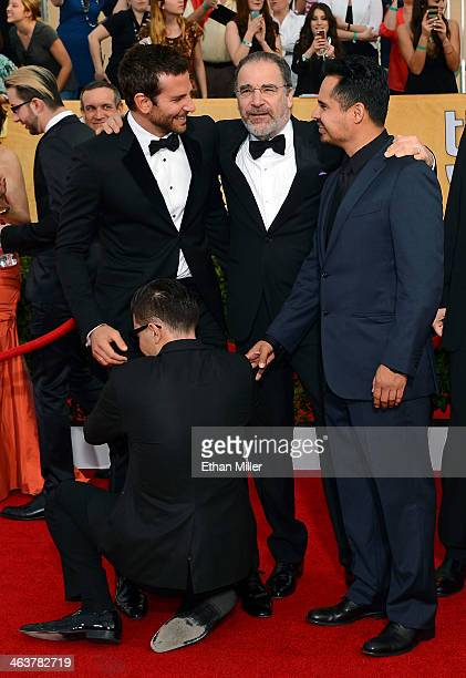 Actors Bradley Cooper Mandy Patinkin and Michael Pena arrive at the 20th Annual Screen Actors Guild Awards at The Shrine Auditorium as Ukrainian...