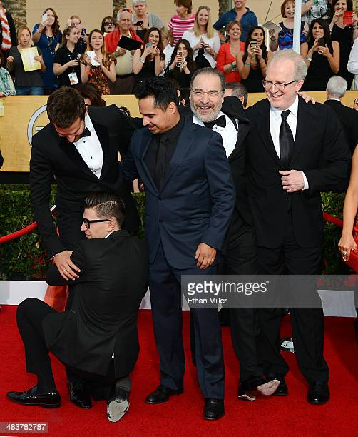 Actors Bradley Cooper Michael Pena and Mandy Patinkin and playwright and actor Tracy Letts arrive at the 20th Annual Screen Actors Guild Awards at...