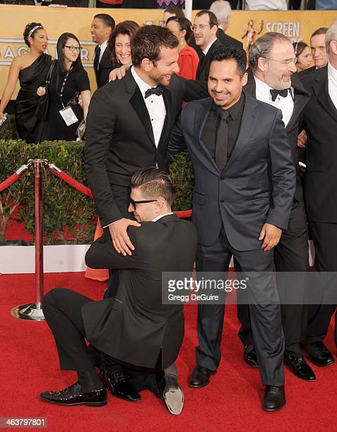 Actors Bradley Cooper Michael Pena and Vitalii Sediuk arrive at the 20th Annual Screen Actors Guild Awards at The Shrine Auditorium on January 18...