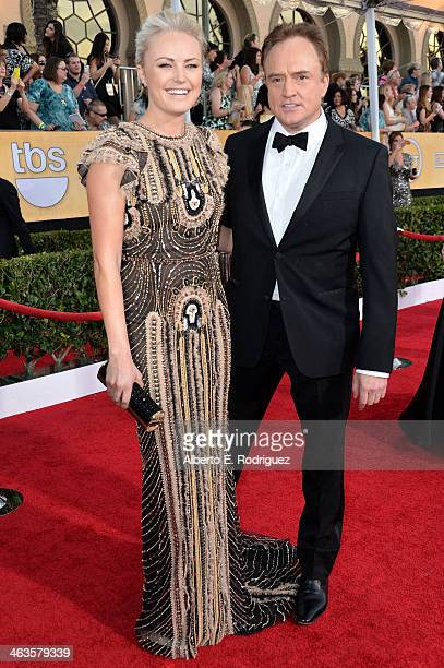 Actors Bradley Whitford and Malin Akerman attend the 20th Annual Screen Actors Guild Awards at The Shrine Auditorium on January 18 2014 in Los...