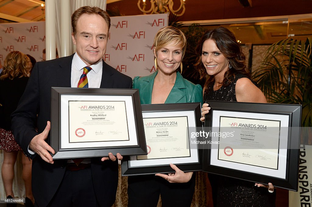 Actors Bradley Whitford, Melora Hardin and Amy Landecker (L-R) pose with their awards at the 15th Annual AFI Awards Luncheon at Four Seasons Hotel Los Angeles at Beverly Hills on January 9, 2015 in Beverly Hills, California.