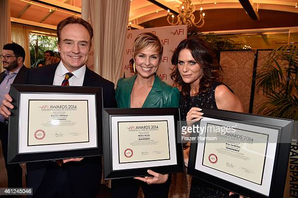 Actors Bradley Whitford Melora Hardin and Amy Landecker pose with awards during the 15th Annual AFI Awards at Four Seasons Hotel Los Angeles at...