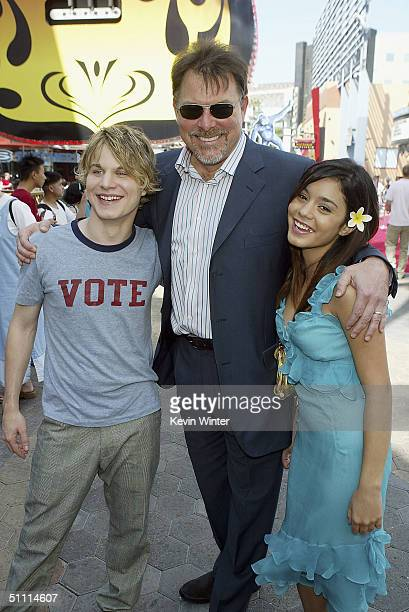 Actors Brady Corbett and Vanessa Anne Hudgens pose with director Jonathan Frakes at the premiere of Thunderbirds at the Universal Studios Cinemas on...