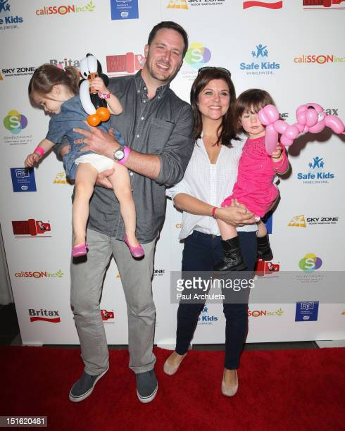 Actors Brady Smith and Tiffani Thiessen attend the 2nd annual Red CARpet event at the SLS Hotel on September 8 2012 in Beverly Hills California