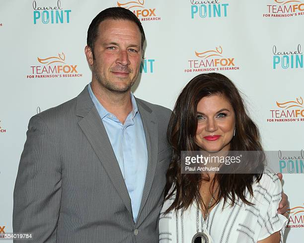 Actors Brady Smith and Tiffani Thiessen attend the Raising The Bar To End Parkinson's at Laurel Point on July 27 2016 in Studio City California