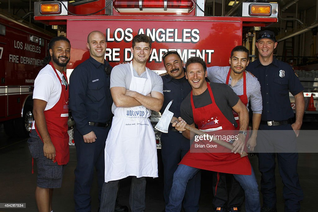 Actors Brandon Jay McLaren, Kevin Bigley, Mark Feurstein and Rick Gonzales with members of the LAFD participate in the Hollywood Chamber Of Commerce Annual Police And Fire department appreciation BBQ on August 27, 2014 in Hollywood, California.