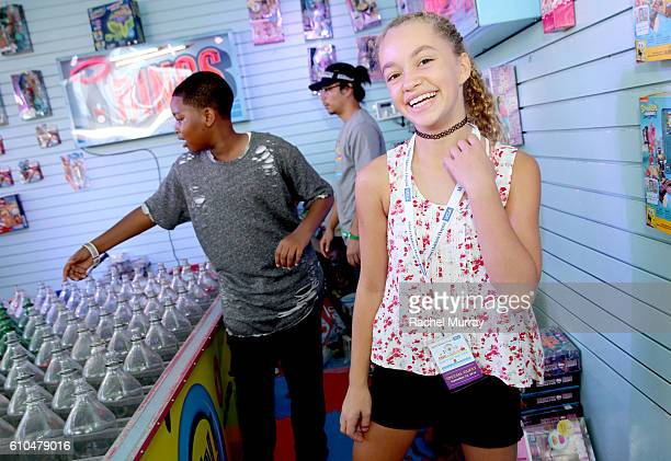 Actors Brandon Severs and Jillian Shea Spaeder play with ring toss with guests at the Ring Toss both during the 17th Annual Mattel Party on the Pier...