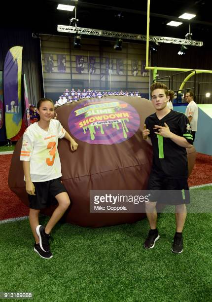 Actors Breanna Yde and Ricardo Hurtado attend the Superstar Slime Showdown taping at Nickelodeon at the Super Bowl Experience on February 1 2018 in...