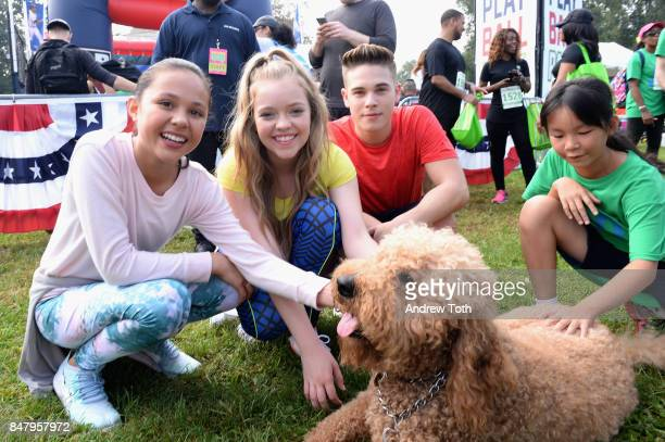 Actors Breanna Yde Jade Pettyjohn and Ricardo Hurtado attend Nickelodeon's Worldwide Day Of Play Celebration at the Nethermead in Prospect Park on...
