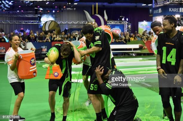 Actors Breanna Yde Ricardo Hurtado NFL palyer Luke Kuechly former NFL player Deion Sanders and NFL player Stefon Diggs attend the Superstar Slime...