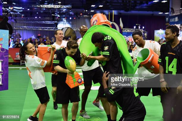 Actors Breanna Yde Ricardo Hurtado NFL palyer Luke Kuechly former NFL player Deion Sanders and NFL player Stefon Diggs attend the Superstar Slime...