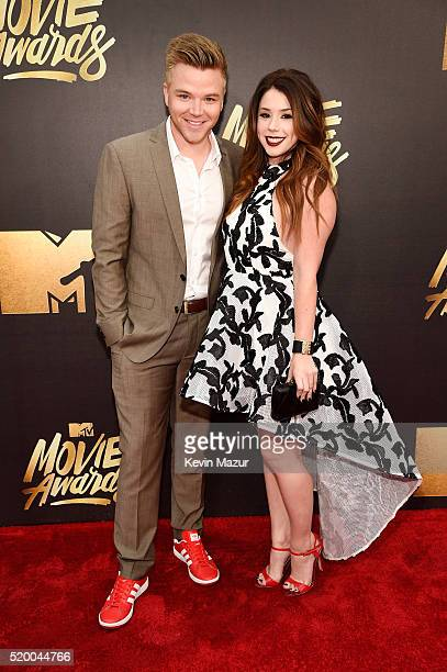 Actors Brett Davern and Jillian Rose Reed attend the 2016 MTV Movie Awards at Warner Bros Studios on April 9 2016 in Burbank California MTV Movie...