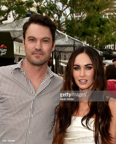 Actors Brian Austin Green and Megan Fox attend the block party for the premiere of Paramount Pictures' 'Teenage Mutant Ninja Turtles' at Regency...