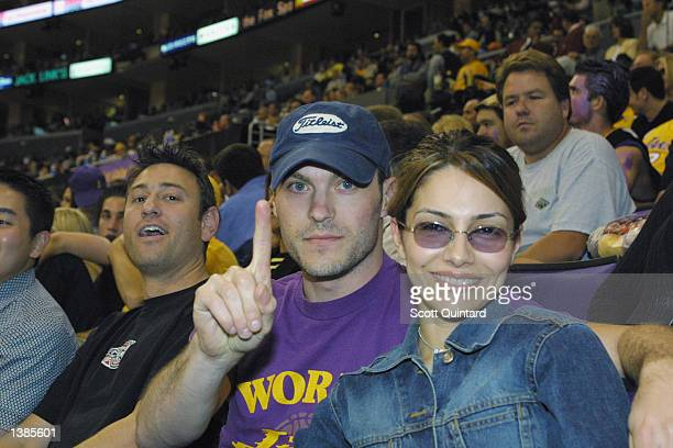 Actors Brian Austin Green and Vanessa Marcil attend Game two of the 2002 NBA Finals between the New Jersey Nets and the Los Angeles Lakers on June 7...