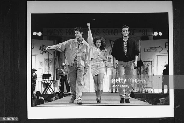 Actors Brian Austin Green Gabrielle Carteris Luke Perry all sporting jean outfits which incl jackets as they walk down runway during fashion show for...