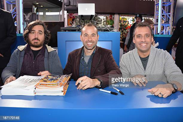 Actors Brian Quinn James Murray and Joe Gatto pose at the Guinness World Records Unleashed Arena in Times Square on November 6 2013 in New York City...
