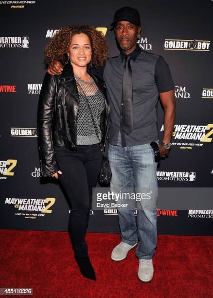 Actors Bridgid Coulter and Don Cheadle arrive at Showtime's VIP prefight party for Mayhem Mayweather vs Maidana 2 at the MGM Grand Garden Arena on...