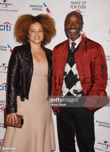 Actors Bridgid Coulter and Don Cheadle arrive at the Universal Music Group's 2017 GRAMMY After Party at The Theatre at Ace Hotel on February 12 2017...