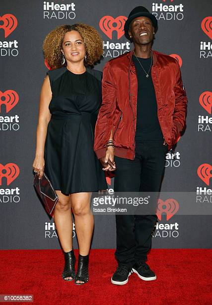 Actors Bridgid Coulter and Don Cheadle attend the 2016 iHeartRadio Music Festival at TMobile Arena on September 23 2016 in Las Vegas Nevada