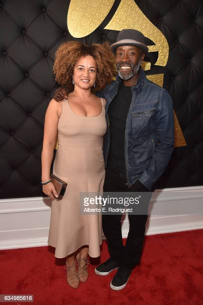 Actors Bridgid Coulter and Don Cheadle attend The 59th GRAMMY Awards at STAPLES Center on February 12 2017 in Los Angeles California