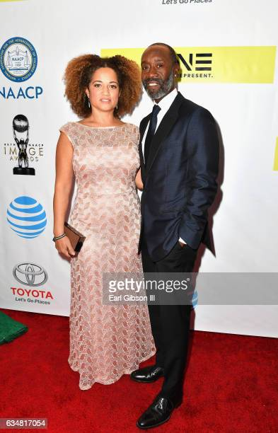 Actors Bridgid Coulter and Don Cheadle attends the 48th NAACP Image Awards at Pasadena Civic Auditorium on February 11 2017 in Pasadena California