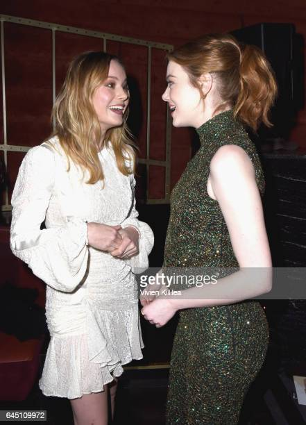 Actors Brie Larson and Emma Stone attend the tenth annual Women in Film PreOscar Cocktail Party presented by Max Mara and BMW at Nightingale Plaza on...