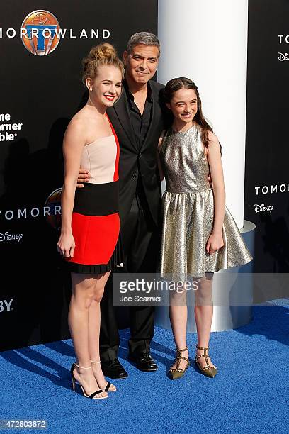 Actors Britt Robertson George Clooney and Raffey Cassidy attend Disney's 'Tomorrowland' Los Angeles premiere at AMC Downtown Disney 12 Theater on May...