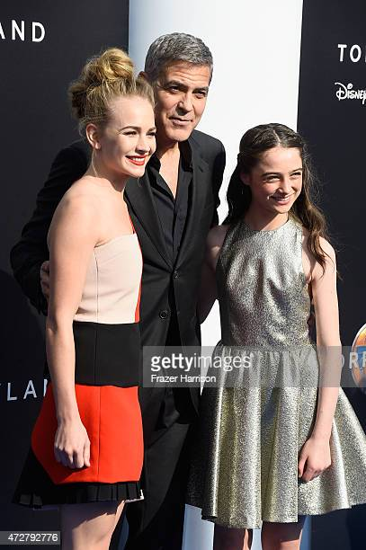 Actors Britt Robertson George Clooney and Raffey Cassidy attend the premiere of Disney's 'Tomorrowland' at AMC Downtown Disney 12 Theater on May 9...