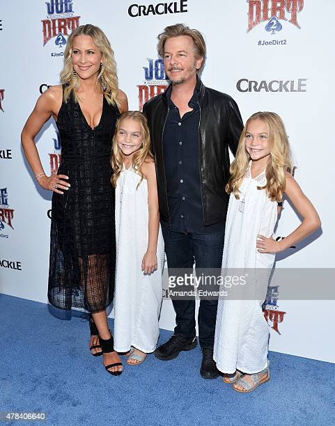 Actors Brittany Daniel Allison Gobuzzi David Spade and Lauren Gobuzzi arrive at the world premiere of Joe Dirt 2 Beautiful Loser hosted by Crackle at...