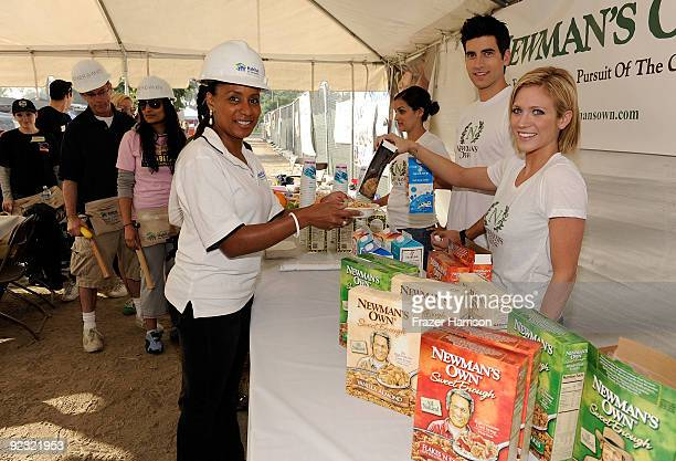 Actors Brittany Snow and Ryan Rottman serve breakfast to JoAn Turman Senior Director of Communications and Marketing for Habitat for Humanity at the...